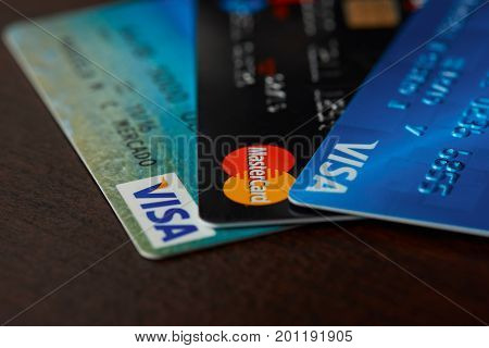 New york, USA - August 24, 2017: Bank cards laying on wooden background close-up