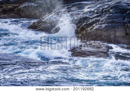 Roaring Ocean Waves on Lofoten Stony Islands Shore Line During Beginning of Spring.Horizontal Image Composition