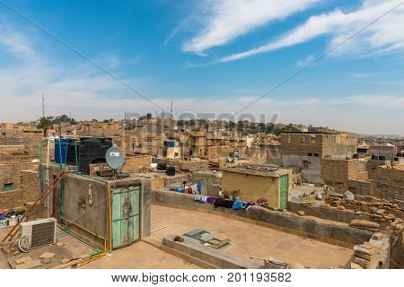 JAISALMER RAJASTHAN INDIA - MARCH 07 2016: Houses view from Saalam Singh Ki Haweli rooftop carved yellow sandstone architecture in Jaisalmer known as Golden City in India.