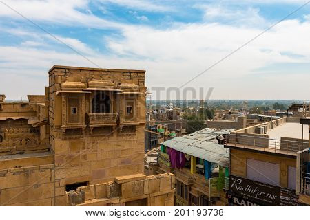 JAISALMER RAJASTHAN INDIA - MARCH 07 2016: From the rooftop Saalam Singh Ki Haweli carved yellow sandstone architecture in Jaisalmer known as Golden City in India.