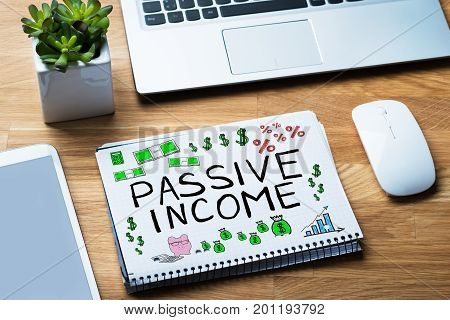 Passive Income Words In Notepad At Desk
