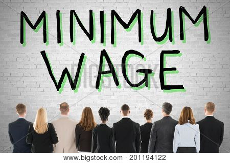 Group Of People Looking At Minimum Wage And Social Security