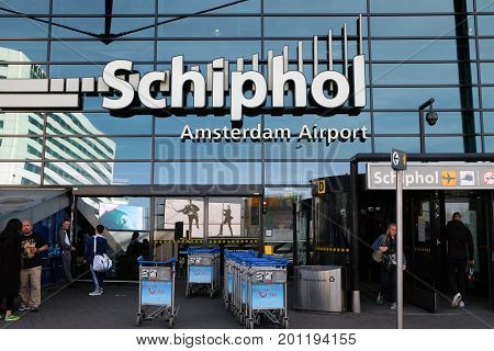 SCHIPHOL HOLLAND - MAY 17 2017: Entrance for passengers to the Amsterdam Airport Schiphol