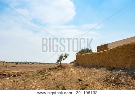 Horizontal picture of the wall of traditional houses in Thar Desert located close to Jaisalmer the Golden City in India.