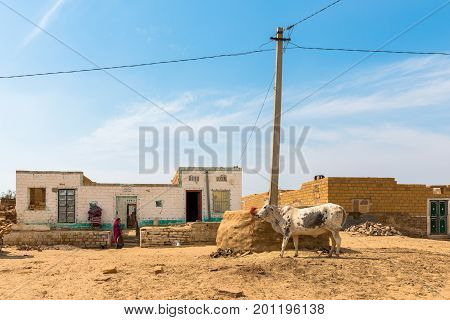 RAJASTHAN INDIA - MARCH 07 2016: Wide angle picture of traditional houses in Thar Desert located close to Jaisalmer the Golden City in India.