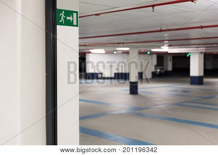 Emergency exit sign at entrance of underground parking lot