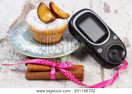 Glucometer, Muffins With Plums And Cinnamon Sticks, Delicious Dessert And Checking Sugar Level Conce