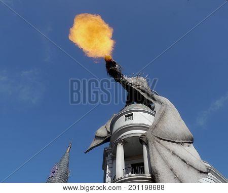 ORLANDO, FLORIDA, USA--The Gringotts Bank dragon spits fire at the Universal Studios theme park in Orlando, Florida. Photo taken in August 2015.