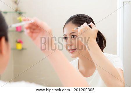Smiling Beautiful Woman Looking At Mirror