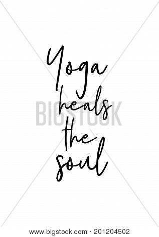 Hand drawn holiday lettering. Ink illustration. Modern brush calligraphy. Isolated on white background. Yoga heals the soul.