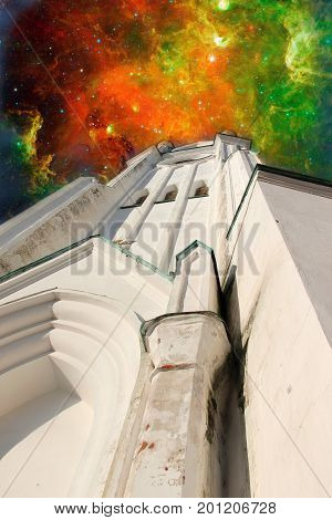 Sophia cathedral in the Vologda city, Russia. Summer sunny day. Bell tower. Elements of this image furnished by NASA. Deep space filled with stars, nebula and galaxy.