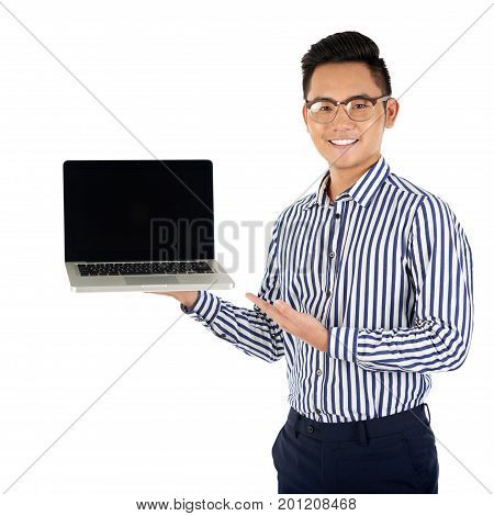 Portrait of cheerful software developer showing opened laptop