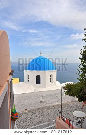 blue dome on white greek orthodox chapel on greek island Santorini, greece