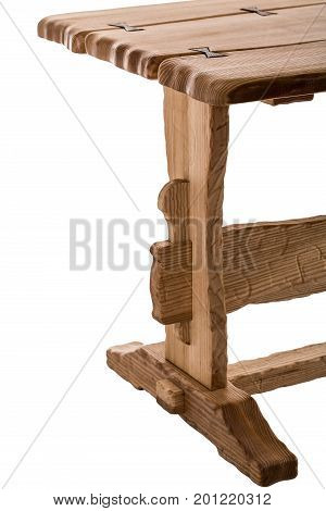 Part of wooden brown antique table isolated on white background. dining square table. Handmade table, furniture.