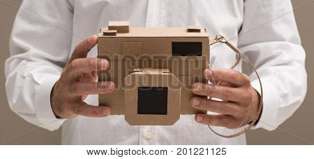 Photographer Holding A Cardboard Camera