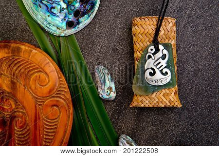 New Zealand - Maori Themed Objects - Metal And Greenstone Pendant, Wooden Mere With Flax Leaves And