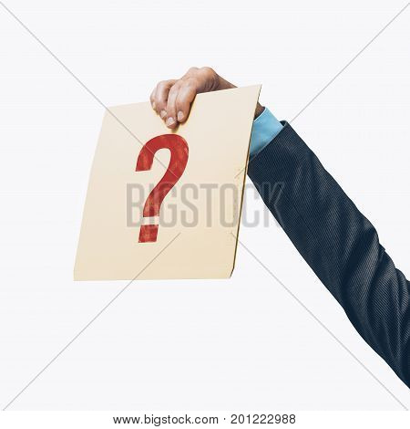 Businessman Holding A File With A Question Mark