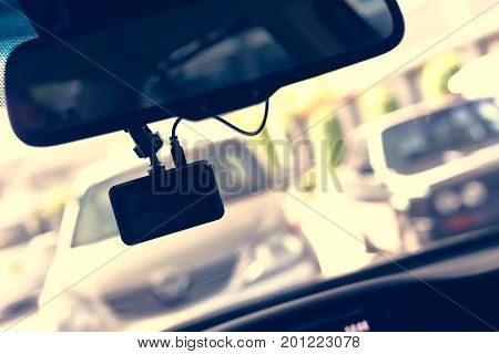 Driving Car With Video Camera Record Technology On Windscreen
