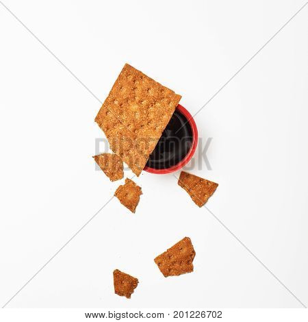 Minimalism. Red Cup Of Coffee Or Tea Among Fresh Healthy Rusks