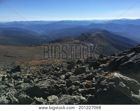 View over the hill with mountain trail on the background.  Beautiful american landscape with a mountain path. Mountain trail scenery. Mount Washington, Bretton Woods, New Hampshire, US .