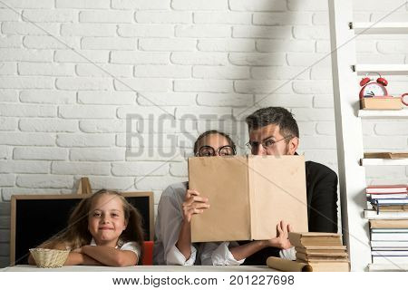 Teacher And Schoolgirls On Classroom Background. Kid With Happy Face