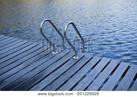 Scale on the pontoon of a lake
