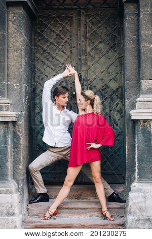 Sexy Couple Of Dancers Posing Near Old Wall Outdoors, Newlywed Couple On Honeymoon Dancing Outdoors,