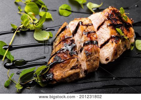 Roasted Chicken Breast on a Black Stone Plate with Balsamic Vinegar and Oregano Crispy and Healthy