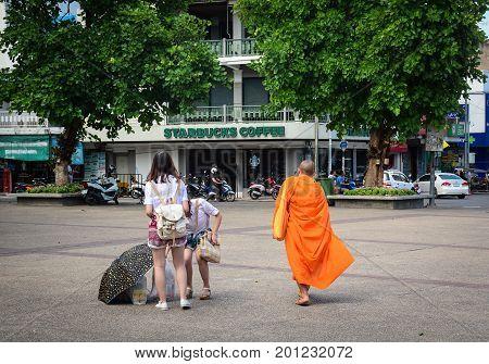 Buddhist Monks Walking On Street In Thailand
