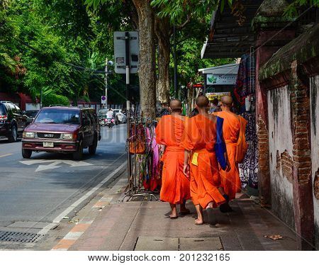 Buddhist Monks Walking On Street In Thailand