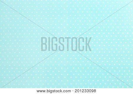 Mint fabric background with polka dot