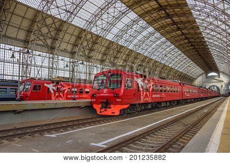 MOSCOW, RUSSIA - MAY 05, 2017: Two red Aeroexpress trains standing at a gigantic landing platform of Moscow Kiyevskaya railway station and Shukhov's steel-and-glass roof of Kiyevsky station