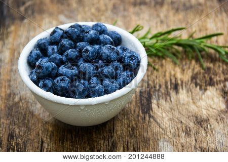 Fresh ripe blueberries in a white bowl. A useful snack