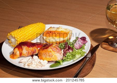 Healthy diet hunters chicken dinner with BBQ sauce. Nutritional slimmers meal with wine.