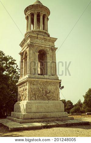 The Mausoleum of the Julii at Glanum near Saint-Rémy de Provence (France). Edited as a vintage photo with dark edges.