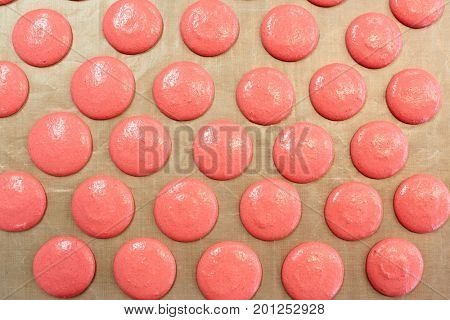 cooking food and confectionery concept - macaron batter or meringue cream on baking paper at pastry shop