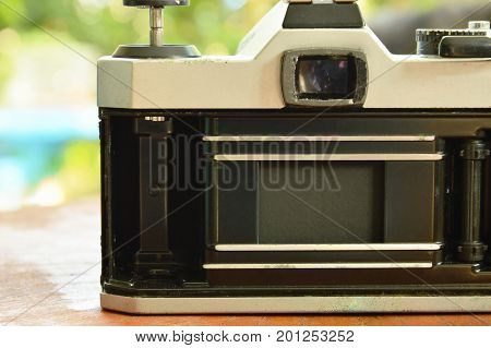 single lens reflect camera open film pressure plate and showing shutter curtain