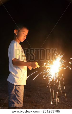 Japanese Boy Doing Handheld Fireworks (second Grade At Elementary School)