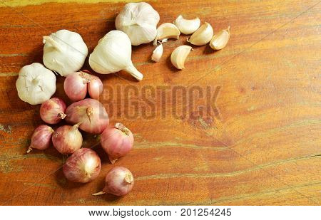 garlic and shallot fresh herb and spice on wooden table