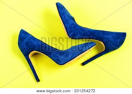 Blue Shoes Lying On Yellow Background