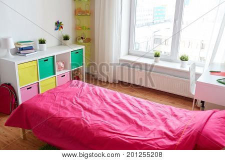 interior, home and furnishing concept - kids room with bed, rack, table and accessories