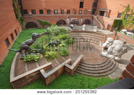 MOSCOW RUSSIA - AUGUST 20 2017: Statues of dinosaurs and a statue of mammoth at Paleontological Museum. The museum is named after Yuri Orlov (1893-1966).