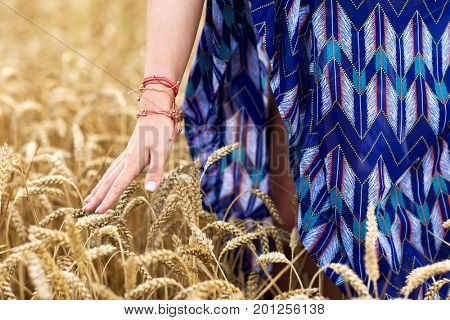 nature, youth culture and people concept - close up of young hippie woman on summer cereal field
