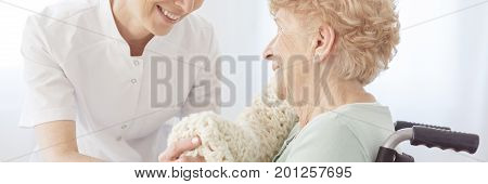 Nurse Laying Blanket On Patient