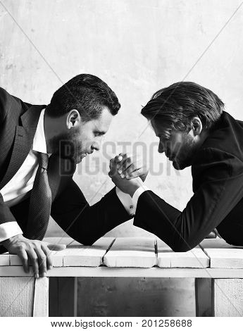 Managers. Arm Wrestling Between Employees