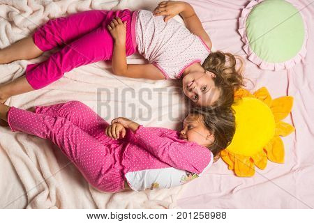 Childhood, Party And Happiness Concept. Kids In Pink Pajamas