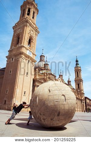 ZARAGOZA, SPAIN - AUGUST 19, 2017: Tourists at the Plaza del Pilar square, in Zaragoza, Spain, with the Cathedral-Basilica of Our Lady of the Pillar in the background