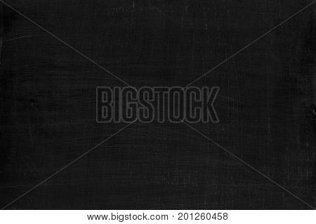 Black scratched laconic wooden background or texture