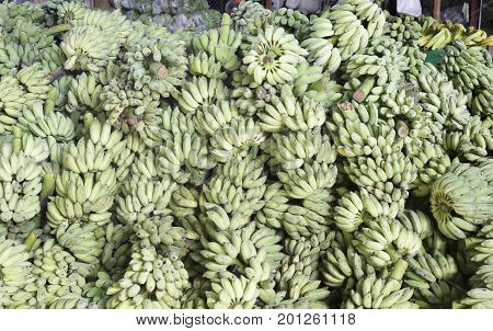 The green bananas in market, Thailand .