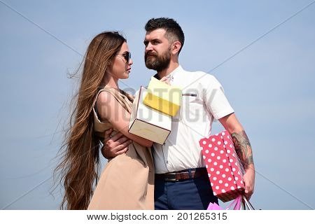 Couple Carries Pink Packets And Box Isolated On Blue Background